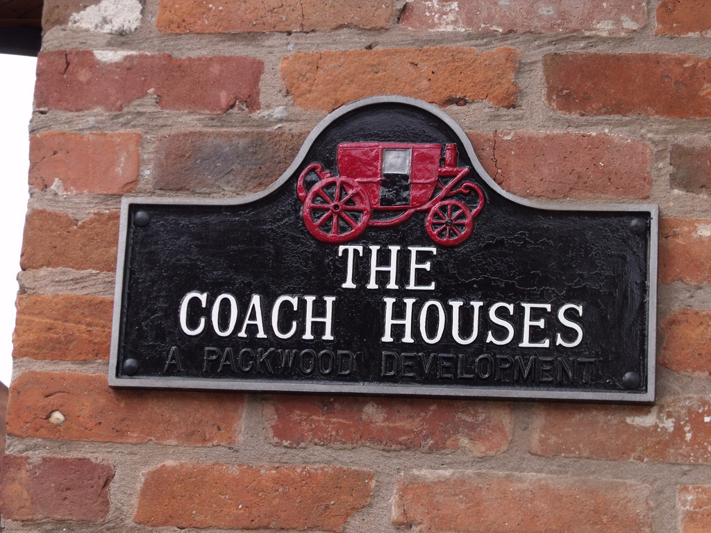 Road sign with the words The Coach Houses written on it
