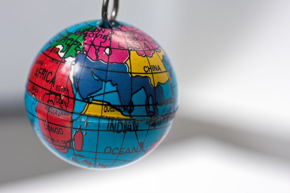 Old key chain toy representing a tiny version of the Earth globe. It shows a coarse division into major countries and regions of the world. The shapes of the continents however are pretty inexact. It is showing the Middle East and Indian Ocean regions.