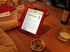 The Cross-Cultural Compass e-book on an iPad on a wooden table with a coffee