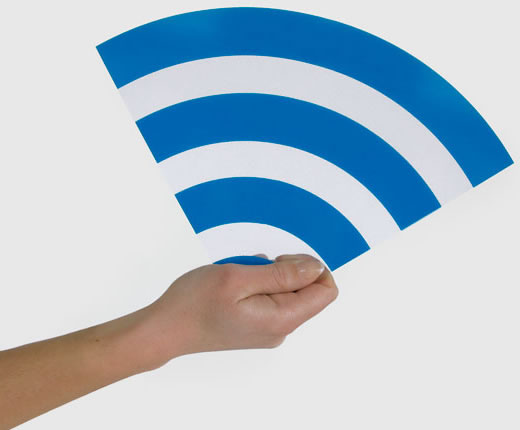 Human Hand holding a Wi-Fi symbol in the air